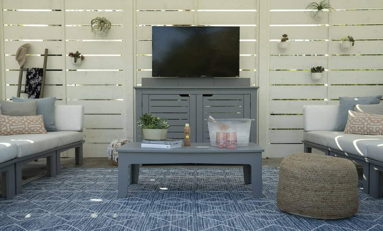 Ledge Lounger Mainstay Bar Credenza with television installed atop of it.
