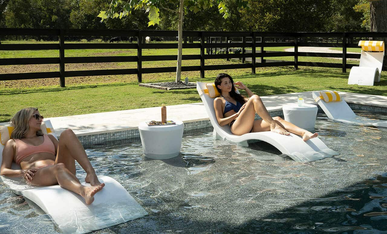 Ledge Loungers in pool furniture on Signature Riser.